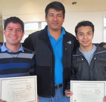 "Celson and Jacinto receiving their ""top student"" awards for excellence in their ESL courses!"